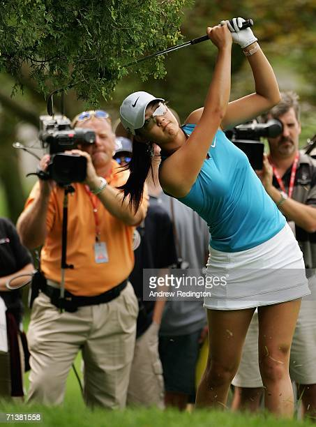 Michelle Wie hits a shot from the rough on the first hole during the first round of the HSBC Women's World Match Play Championship at Hamilton Farm...