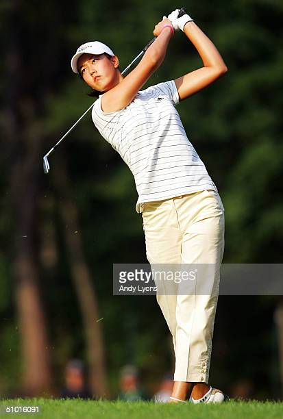 Michelle Wie hits her second shot on the par 4 12th hole during the first round of the U.S. Women's Open on July 1, 2004 at Orchards Golf Club in...