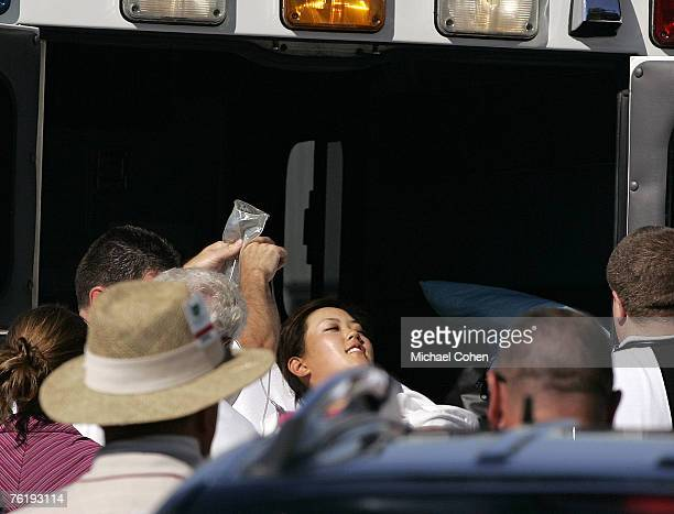 Michelle Wie is placed in an ambulance during the second round of the John Deere Classic at TPC Deere Run in Silvis Illinois on July 14 2006 Wie...