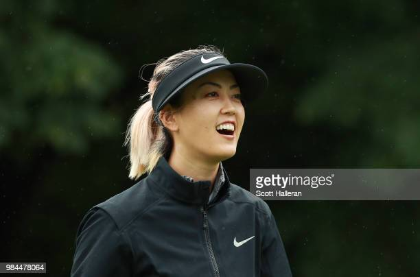 Michelle Wie laughs with her caddie during the proam prior to the start of the KPMG Women's PGA Championship at Kemper Lakes Golf Club on June 26...