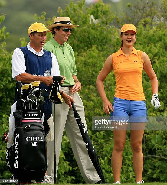Michelle Wie laughs with her swing coach David Leadbetter and her caddie Greg Johnston during the Wednesday practice round of the 2006 Women's US...