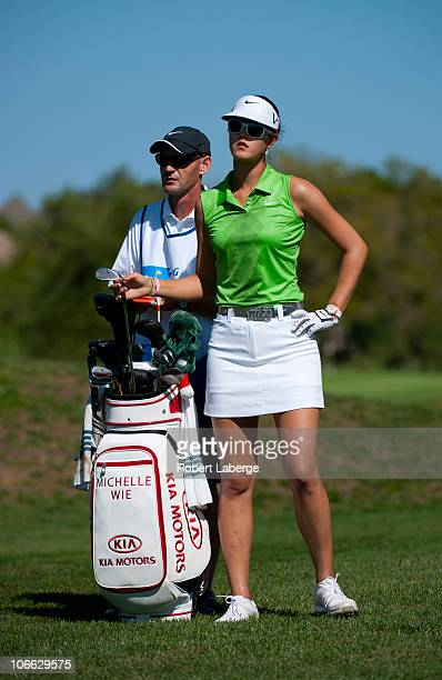 Michelle Wie looks on while alongside her caddie during the second round of the PG NW Arkansas Championship at the Pinnacle Country Club on September...