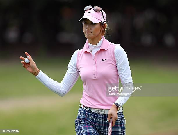 Michelle Wie of Honolulu Hawaiireacts after a putt on the green during the first round of the 2013 North Texas LGPA Shootout at the Las Colinas...
