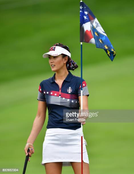 Michelle Wie of Team USA holds the flag during practice for The Solheim Cup at the Des Moines Country Club on August 16 2017 in West Des Moines Iowa