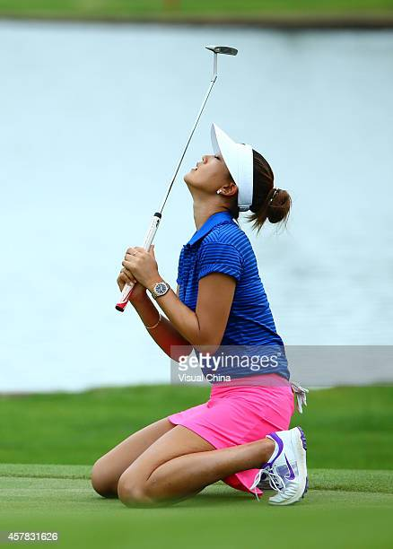 Michelle Wie of the United States celebrates after a shot during day three of the 2014 Blue Bay LPGA at Jian Lake Blue Bay Golf Course on October 25...