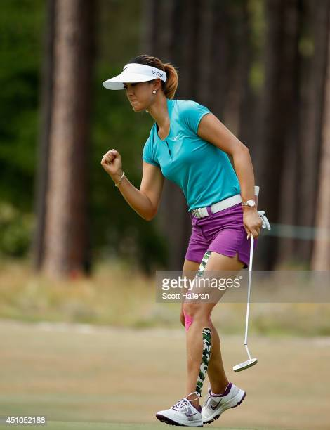 Michelle Wie of the United States celebrates an eagle putt on the tenth green during the final round of the 69th US Women's Open at Pinehurst Resort...