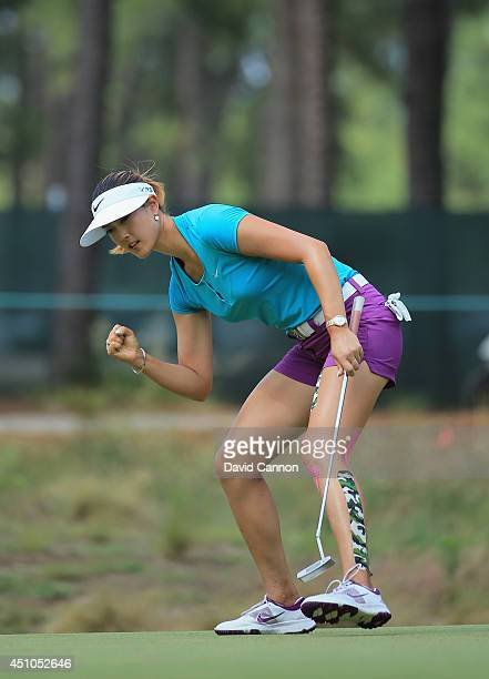 Michelle Wie of the United States celebrates an eagle putt on the tenth green during the final round of the 69th U.S. Women's Open at Pinehurst...
