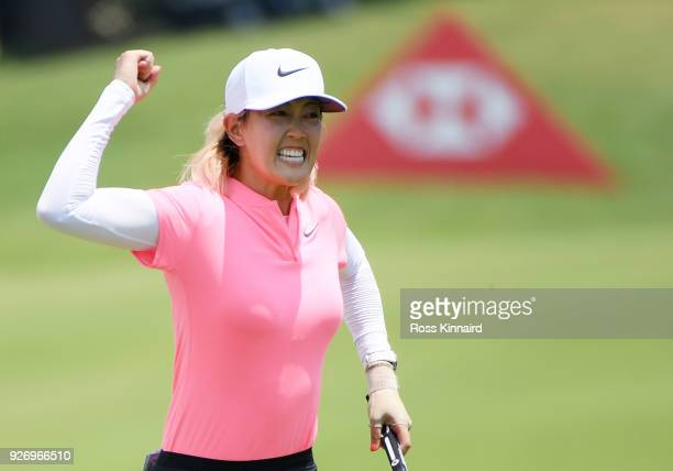 Michelle Wie of the United States celebrates her birdie on the 18th green during the final round of the HSBC Women's World Championship at Sentosa...