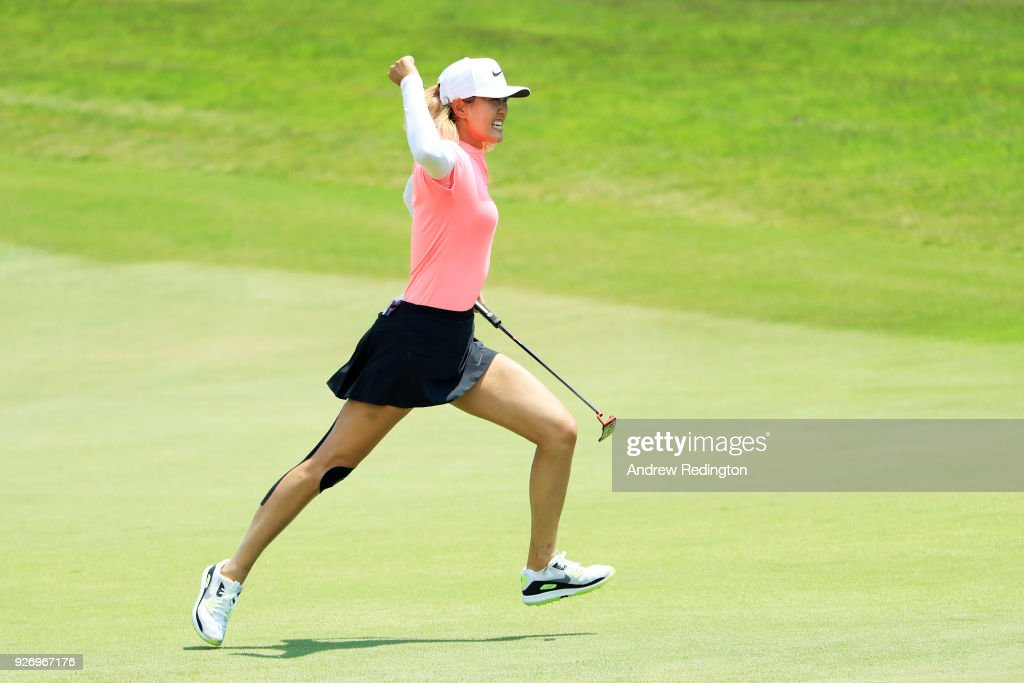 Michelle Wie of the United States celebrates her birdie on the 18th green during the final round of the HSBC Women's World Championship at Sentosa Golf Club on March 4, 2018 in Singapore.