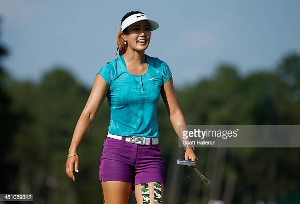 Michelle Wie of the United States celebrates on the 18th green after her twostroke victory at the 69th US Women's Open at Pinehurst Resort Country...