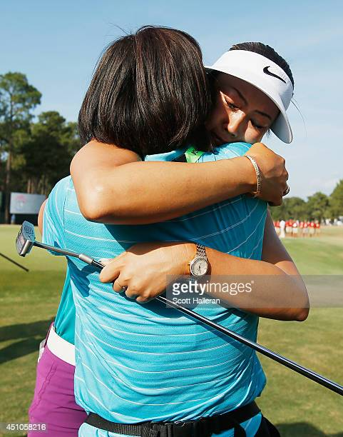 Michelle Wie of the United States celebrates with her mother Bo on the 18th green after her two-stroke victory at the 69th U.S. Women's Open at...