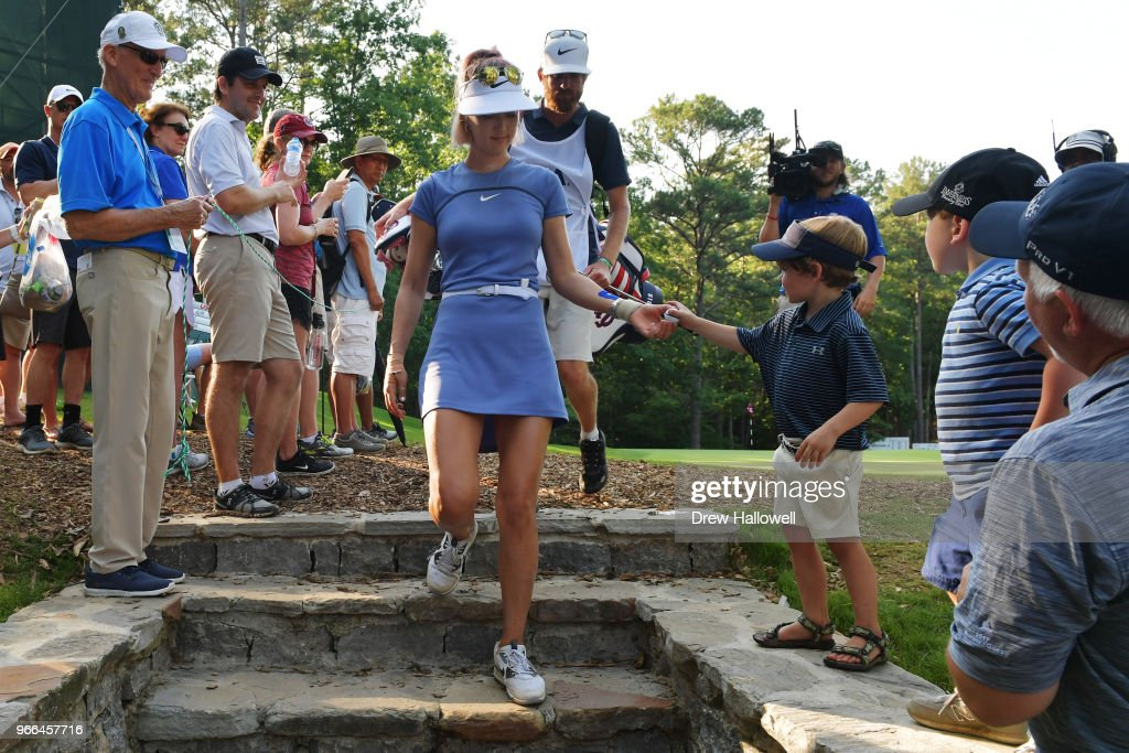 Michelle Wie of the United States hands a young fan a ball after the 13th hole during the third round of the 2018 U.S. Women's Open at Shoal Creek on June 2, 2018 in Shoal Creek, Alabama.