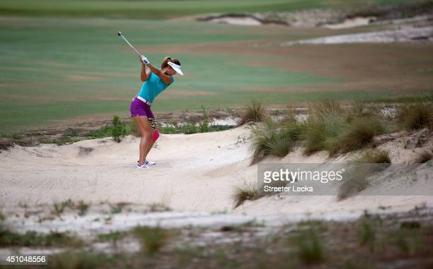 Michelle Wie of the United States hits a shot on the fourth hole during the final round of the 69th U.S. Women's Open at Pinehurst Resort & Country...
