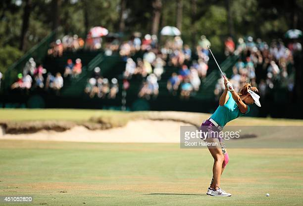 Michelle Wie of the United States hits her approach shot on the tenth hole during the final round of the 69th US Women's Open at Pinehurst Resort...