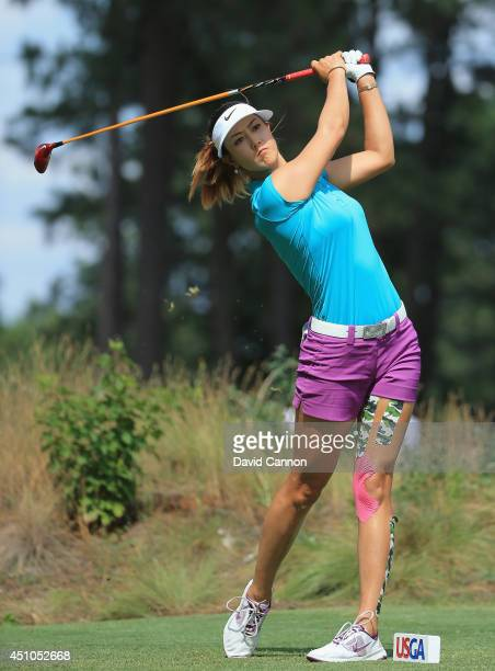 Michelle Wie of the United States hits her tee shot on the 11th hole during the final round of the 69th US Women's Open at Pinehurst Resort Country...