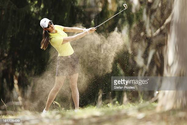 Michelle Wie of the United States hits out of the rough on the 12th hole during day two of the ISPS Handa Australian Open at Royal Canberra Golf Club...