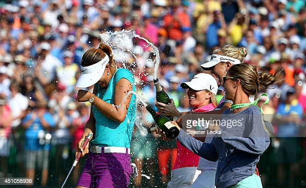 Michelle Wie of the United States is sprayed with champagne by Jamie Kuhn Jessica Korda and Jaye Marie Green after the final round of the 69th US...