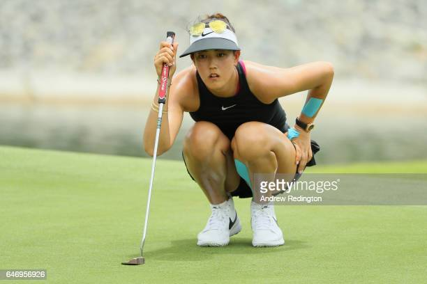 Michelle Wie of the United States lines up her putt on the 17th green during the first round of the HSBC Women's Champions on the Tanjong Course at...