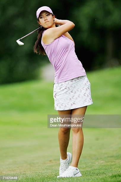Michelle Wie of the United States plays her second shot on the 18th hole during the first round of the Evian Masters on July 26 2006 in Evian France
