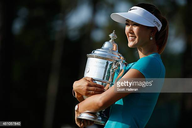 Michelle Wie of the United States poses with the trophy after her twostroke victory at the 69th US Women's Open at Pinehurst Resort Country Club...