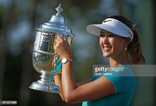 Michelle Wie of the United States poses with the trophy after her two-stroke victory at the 69th U.S. Women's Open at Pinehurst Resort & Country...