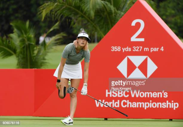 Michelle Wie of the United States reacts to her tee shot from the second tee during round two of the HSBC Women's World Championship at Sentosa Golf...
