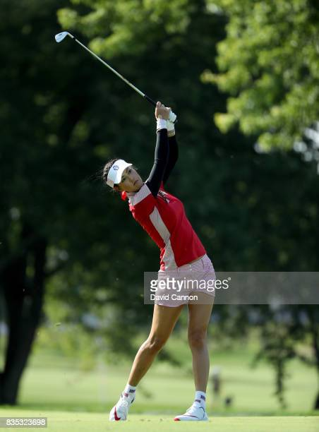 Michelle Wie of the United States Team plays her second shot on the 12th hole in her match with Danielle Kang against Jodi Ewart Shadoff and Madelene...