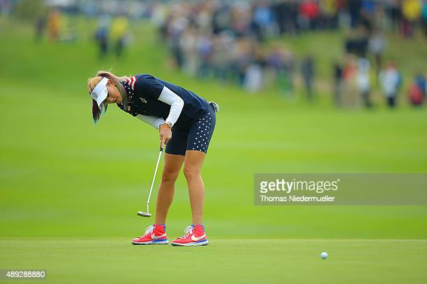 Michelle Wie of the United States Team putts the ball at the first green during the Sundays single matches in the 2015 Solheim Cup at St LeonRot Golf...