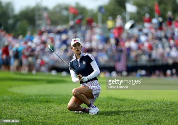 Michelle Wie of the United States team reacts to her second shot on the first hole in her match against Caroline Masson of the European team during...