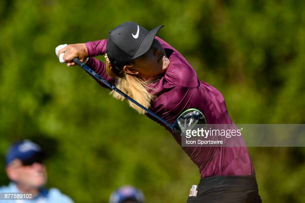 Michelle Wie of the United States tees off on the first hole as part of the last pairing during the final round of the LPGA CME Group Championship at...
