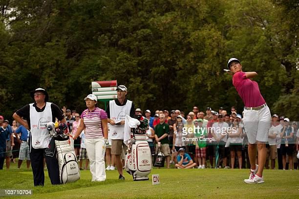 Michelle Wie of the U.S. Follows through on a tee shot during the final round of the CN Canadian Women's Open at St. Charles Country Club on August...