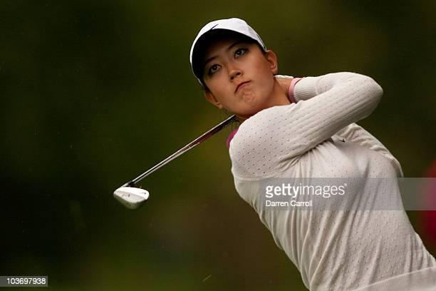 Michelle Wie of the US follows through on an approach shot during the third round of the CN Canadian Women's Open at St Charles Country Club on...