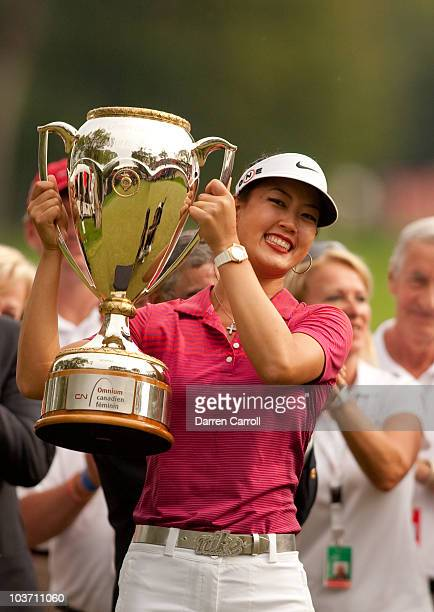 Michelle Wie of the U.S. Holds up the winner's trophy after her victory at the CN Canadian Women's Open at St. Charles Country Club on August 29,...