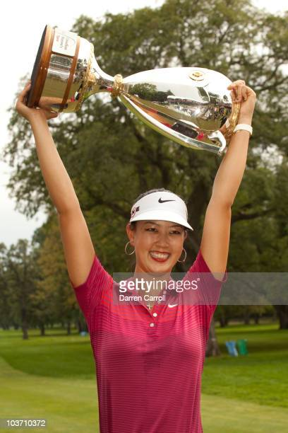 Michelle Wie of the U.S. Poses with the champion's trophy following her victory at the CN Canadian Women's Open at St. Charles Country Club on August...