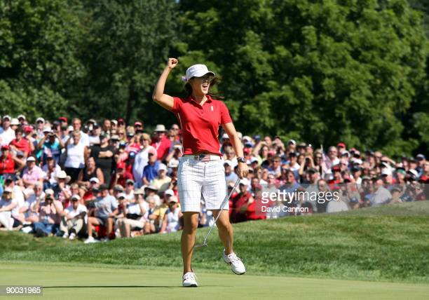 Michelle Wie of the USA birdies the third hole during the Sunday singles matches at the 2009 Solheim Cup Matches at the Rich Harvest Farms Golf Club...