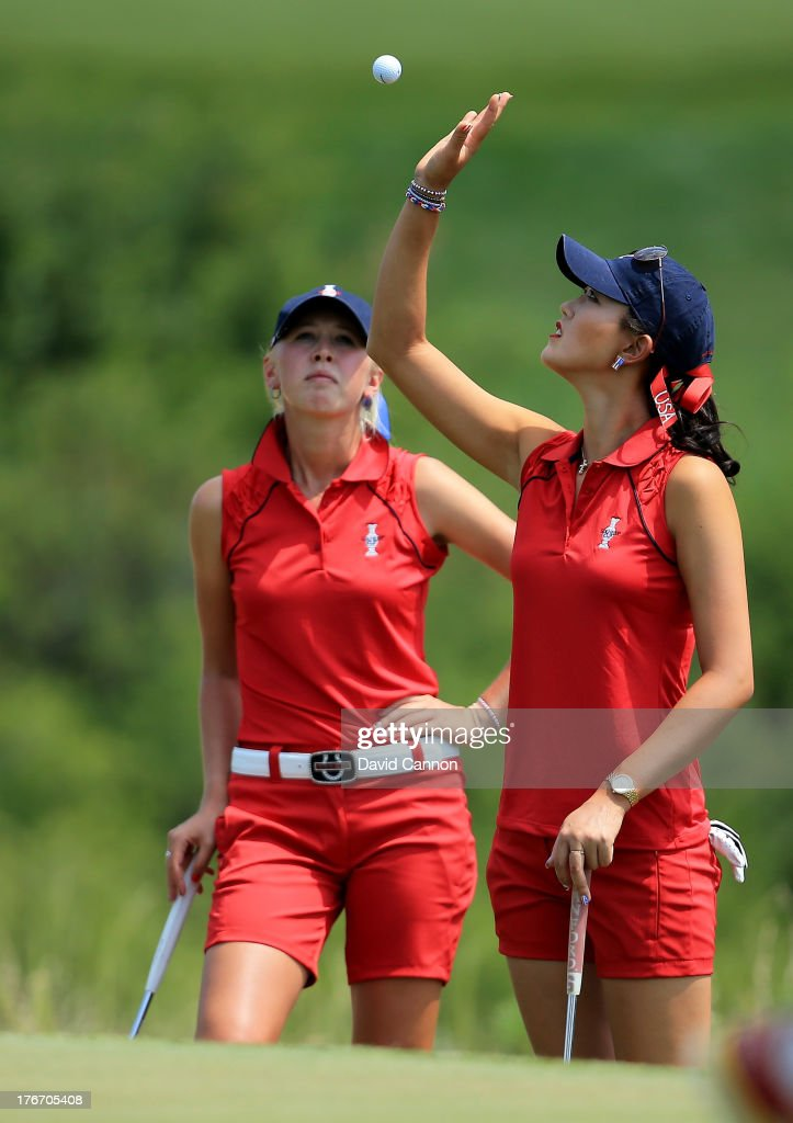 Michelle Wie of the USA catches her ball on the first hole as her partner Jessica Korda looks on during the afternoon fourball matches for the 2013 Solheim Cup at The Colorado Golf Club on August 17, 2013 in Parker, Colorado.
