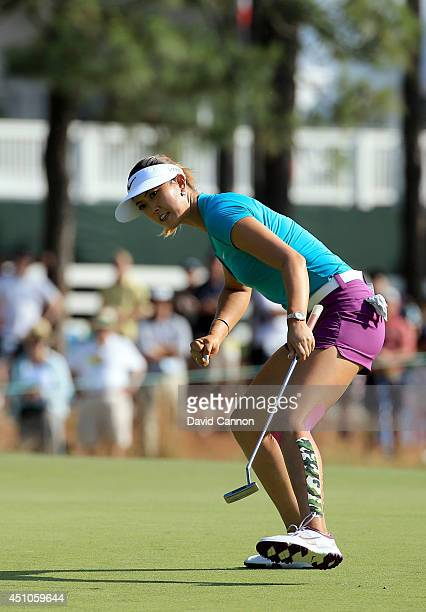 Michelle Wie of the USA celebrates holing a crucial birdie putt at the par 3, 17th hole during the final round of the 69th U.S. Women's Open at...