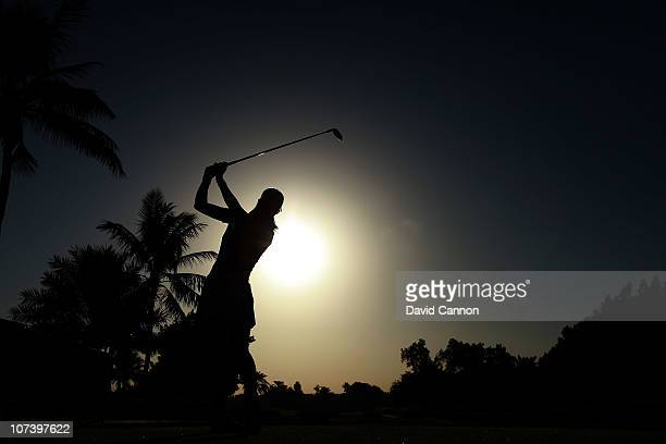 Michelle Wie of the USA drives against the morning sun from the 10th tee during the first round of the 2010 Omega Dubai Ladies Masters on the Majilis...