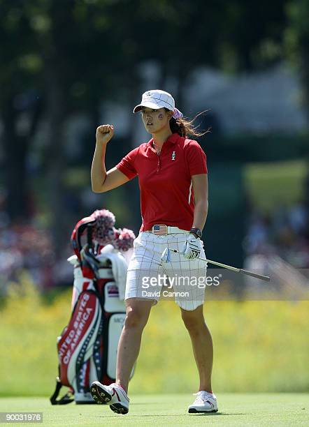 Michelle Wie of the USA hits her second shot close at the 6th hole during the Sunday singles matches at the 2009 Solheim Cup Matches at the Rich...