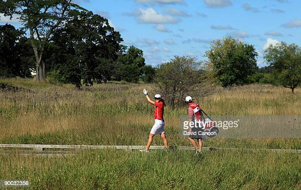 Michelle Wie of the USA leaves the tee on the 1st hole during the Sunday singles matches at the 2009 Solheim Cup Matches at the Rich Harvest Farms...