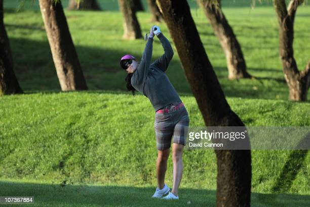 Michelle Wie of the USA plays from trees at the 1st hole during the proam as a preview for the 2010 Dubai Ladies Masters on the Majilis Course at The...