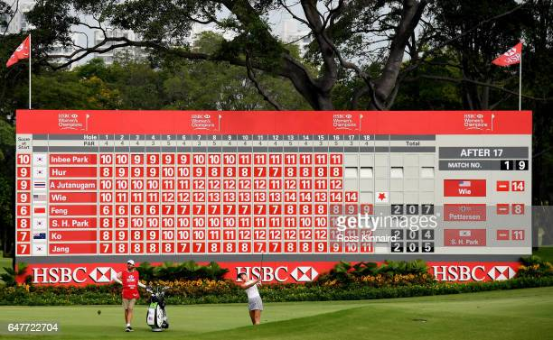 Michelle Wie of the USA plays her second shot on the 18th hole during the third round of HSBC Women's Champions on the Tanjong course at Sentosa Golf...