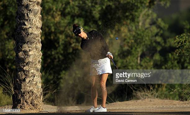 Michelle Wie of the USA plays her second shot on the par 5, 3rd hole during the second round of the 2011 Omega Dubai Ladies Masters on the Majilis...