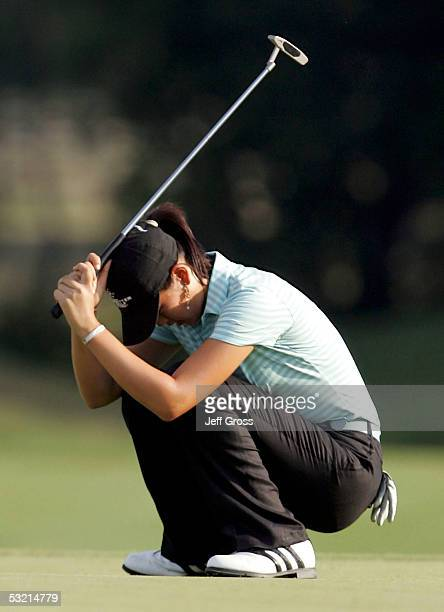 Michelle Wie of the USA reacts after missing a bogie putt on the 6th hole during the second round of the John Deere Classic on July 8 2005 at TPC at...