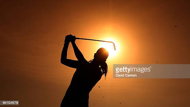 Michelle Wie of the USA tees off against the evening sun during the Challenge Match as a preview for the Dubai Ladies Masters on the par 3 course at...