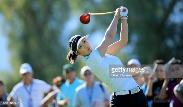 Michelle Wie of the USA tees off on the par 4, 13th hole during the final round of the 2014 Kraft Nabisco Championship on the Dinah Shore Tournament...