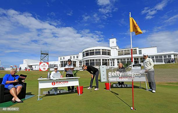 Michelle Wie of the USA the 2014 US Open Champion practices her putting in front of Laura Davies of England Paula Creamer of the USA Lydia Ko of New...