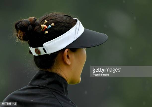 Michelle Wie of the USA with tee pegs in her hair walking off of the 6th tee during the third round of HSBC Women's Champions on the Tanjong course...