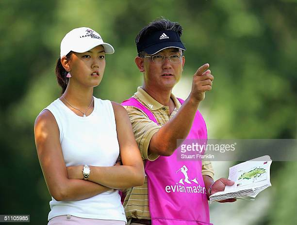 Michelle Wie of USA and father BJ Wie during the second round at The Evian Masters at Evian Golf Club on July 22 2004 in Evian France
