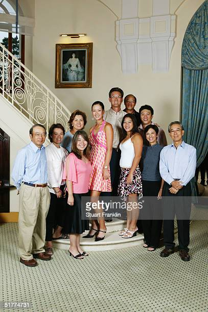 Michelle Wie of USA and her family during a photo shoot at The Royal Park Hotel at The Evian Masters at Evian Golf Club on July 24 2004 in Evian...